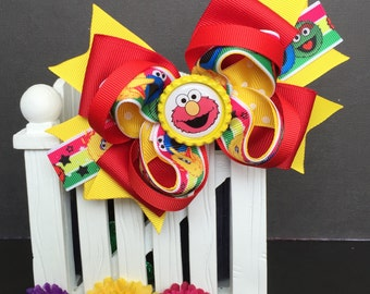 Sesame Street Elmo Cute bow for babies, toddlers and big girls ~ Bow measures approximately 5.5 inches