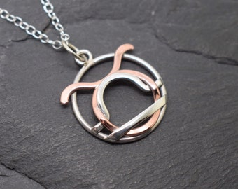 Scorpio Capricorn necklace sterling silver and polished copper with beaded edging