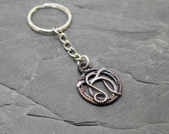 Combined zodiac signs key ring wire wrapped oxidised copper
