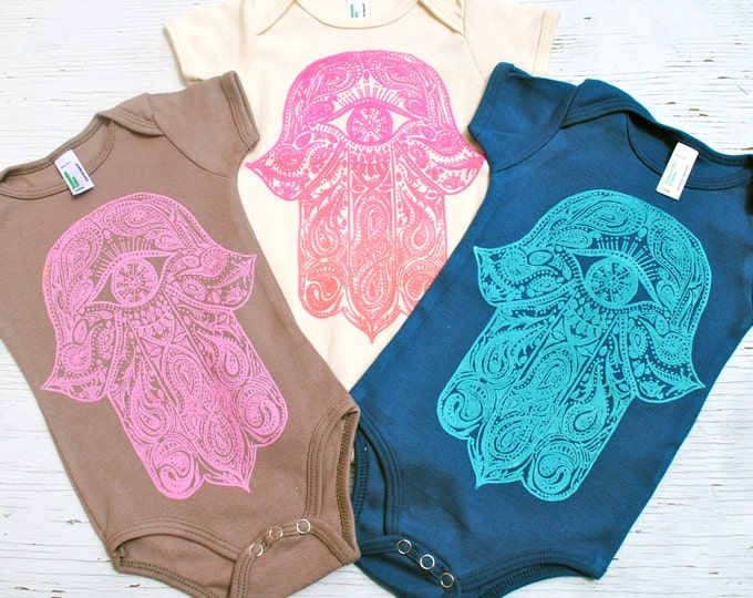 Paisley Hamsa Organic Baby Bodysuit in Natural Creme with sunset ombre print