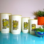 Vintage 1970s Retro Yellow Kitchen Flower Graphic Plastic Nesting Canisters Storage
