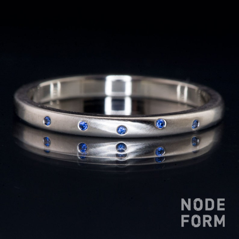Narrow Random Ceylon Blue Sapphire Wedding Band in Platinum image 0
