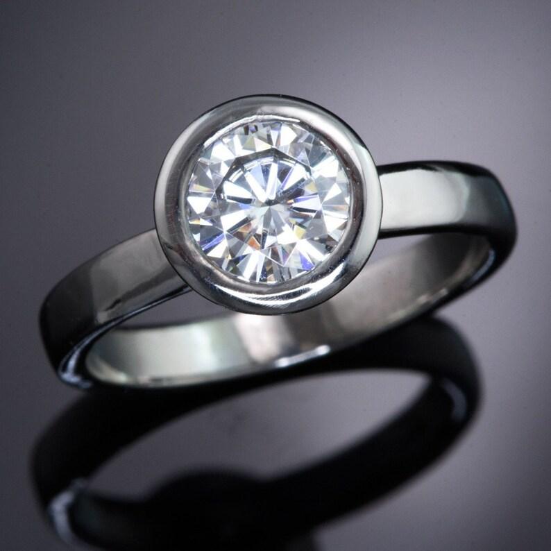 5979b38f6f591 7mm Round Forever One Moissanite Bezel Engagement Ring in Palladium,  Platinum, White Gold, Yellow or Rose Gold, Diamond Alternative