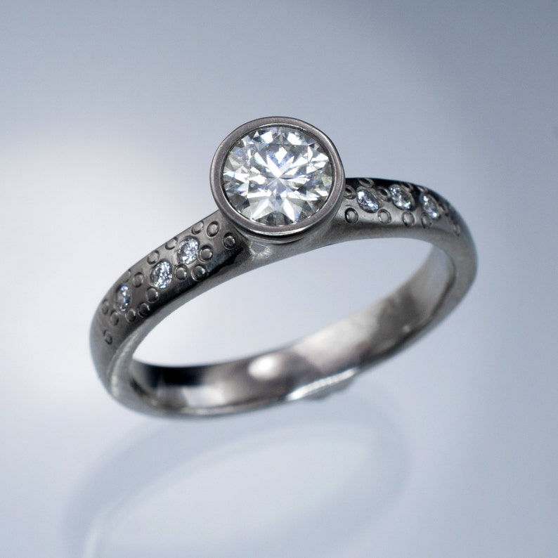 e9f134ab352a6 Forever One Moissanite Engagement Ring, Star Dust Textured Palladium Band,  with accent moissanites, Diamond alternative