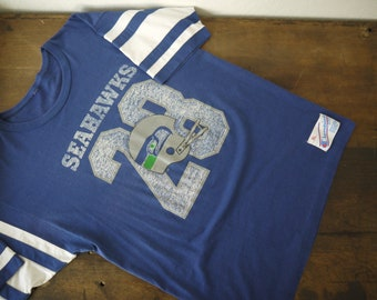20906dce7 Rare Vintage 1980s 80s Seattle Seahawks NFL Jersey Tshirt Tee Shirt - Logo  7   vintage Seattle Seahawks varsity jersey tshirt paper thin