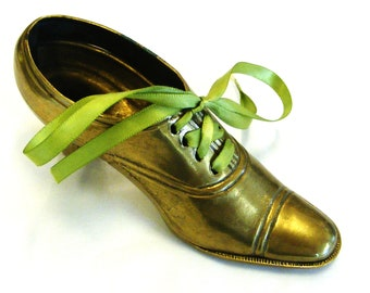 Antique brass shoe with high heel
