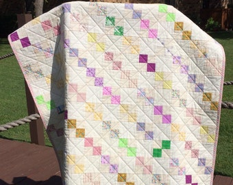 "Pastels And The Scrappy Look Of Vintage Modern In This 39"" X 47.5"" Postage Stamp Quilt"