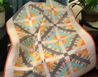 """Gray, Orange, Yellow, Aqua and The Traditional String Quilt Pattern Are Altogether In This 41"""" X 50"""" Quilt"""