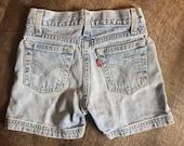 Levi 39 s shorts, child distressed jeans, size 6 6x kids, gender neutral, back to school, light wash denim, Levi strauss, ripped cut shorts