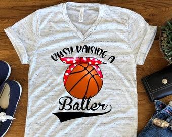 6e5bbfc0 Busy Raising Baller Ballers Basketball Mom Bella White Marble Unisex V Neck  T-Shirt