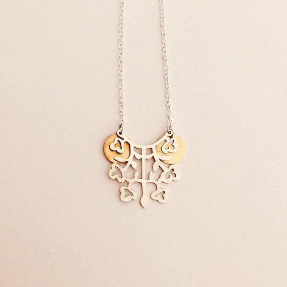 Folk flower necklace in silver