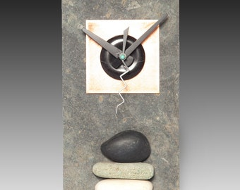slate clock with copper and stone face