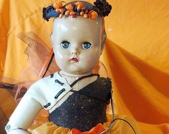 Creepy Halloween princess doll in black and orange dress with pumpkin wand, fairy wings trick or treat assemblage pieces parts