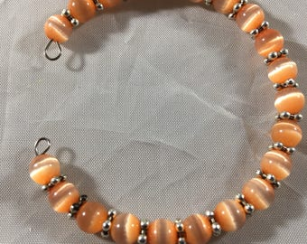 Half cuff peach beaded bracelet