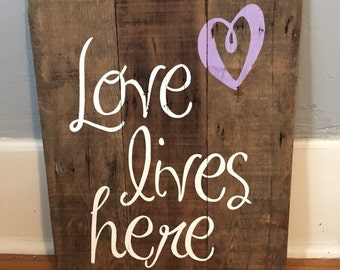 Love lives here reclaimed wood sign