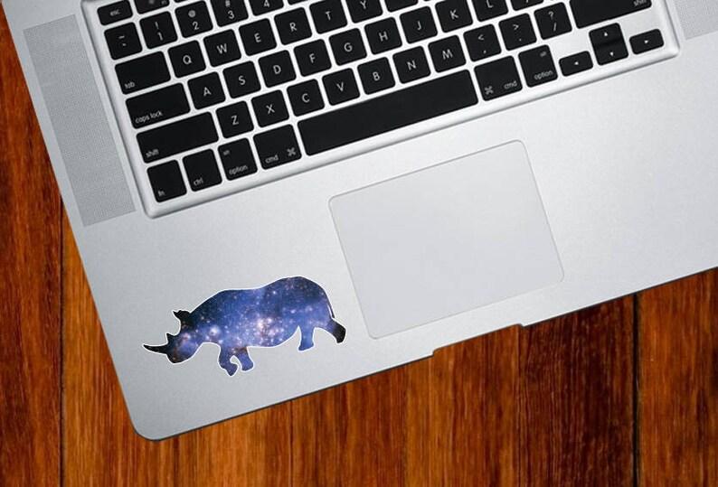 Cosmic Rhinoceros Rhino Spirit Animal 3.5w x 1.5h Vinyl Trackpad Tablet Decal \u00a9YYDC Galaxy Guide CLR:TP