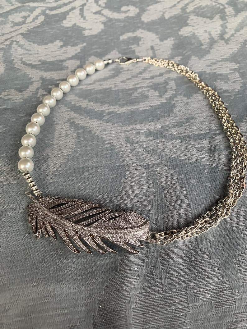 silver chain supporting a beautiful feather focal piece. Feather Gift necklace was created with white pearls