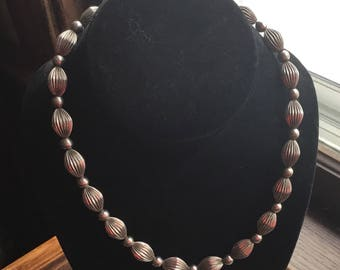 Sterling silver beads strung on a sterling silver chain