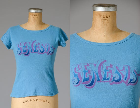 1970s Genesis T Shirt Baby Blue and Pink Cap Sleev