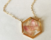 Pressed flower in hexagon gold pendant necklace, resin, filled with pink strawflower petals