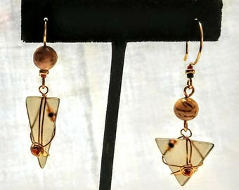Tangora Designs unusual Asymmetrical taupe ear rings. Up cycled wine bottle glass, semiprecious beads, 14.20 Gold fill wire. Great for fall.