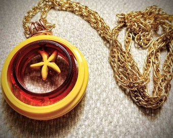 Necklace. Upcycled Mustard yellow and red pendant. Yellow Starfish acrylic bead copper bail and gold tone chain 30in long under 30 USD