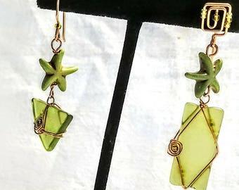 Greenery asymmetrical ear rings from Tangora Designs. Great for casual beach resort wear.