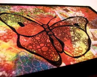 """Art quilt on canvas, butterfly thread stitched/doodled on printed fabric,  8""""x10"""""""