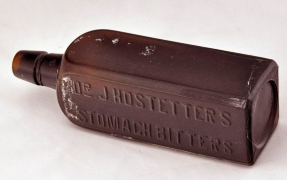 "Antique Ca 1890 Embossed Dr J HOSTETTERs STOMACH BITTERS Mold Amber Bottle 8 3/4""h x 2 9/16""sq 18 Fluid Oz Part Original Bck Label V G Cond"