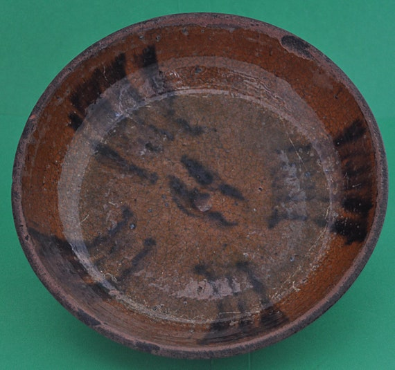 "Antique 1850-1880 REDWARE BROWN SLIP Decorated Bowl w/ 16 Freehand Painted Dark Brown Slip Lines 7 5/8"" di x 1 3/4"" high."