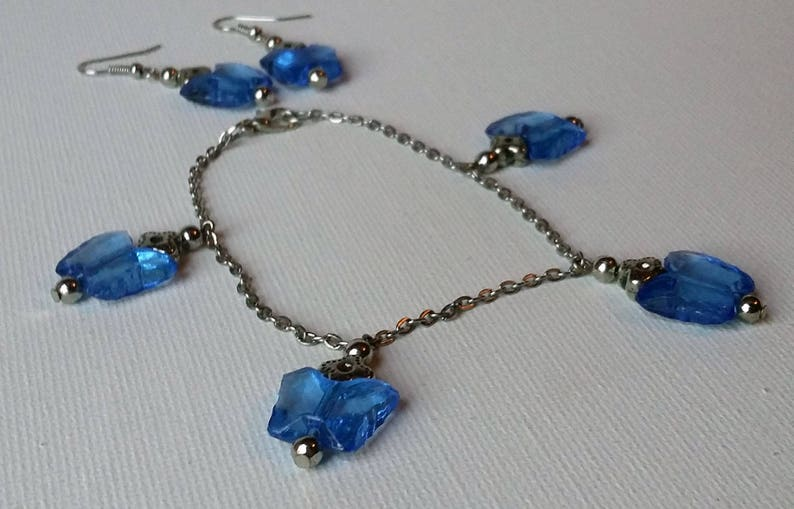 Blue Acrylic Butterfly and Metal Flower Charm Bracelet and Earrings Set
