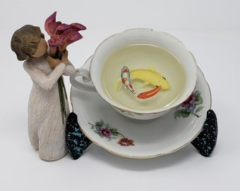 Koi Fish in a Floral Tea Cup