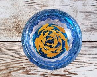 Orange Fish in Clear Blue Cup