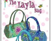 The Layla Bag pattern, from Cool Cat Creations sew a cute fabric quilted bag using sweet or funky fabrics
