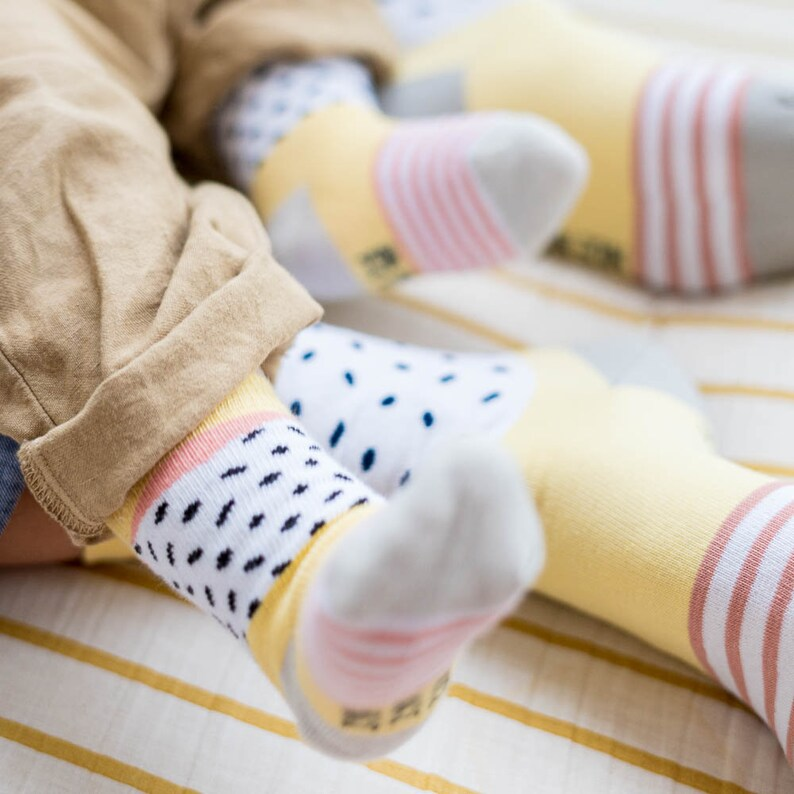 baby socks freckles yellow