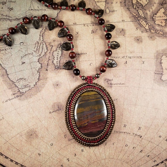 Desert Red Bronze Tiger Iron Pendant on a Red Tiger's Eye Necklace Embellished with Czech Glass Leaves