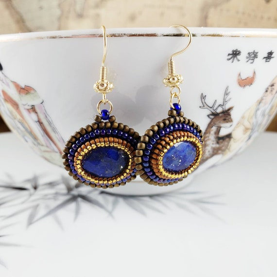 Lapis lazuli blue earrings with hand bead embroidered sunset orange and gold beaded accents