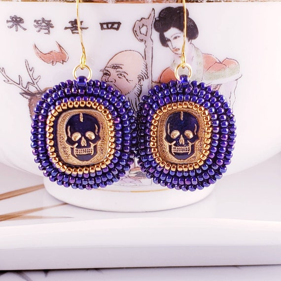 Vintage cobalt blue glass skull earrings.  Hand beaded with opalescent blue glass seed beads.  Foxxy Jewelry CynthiaFoxDesign