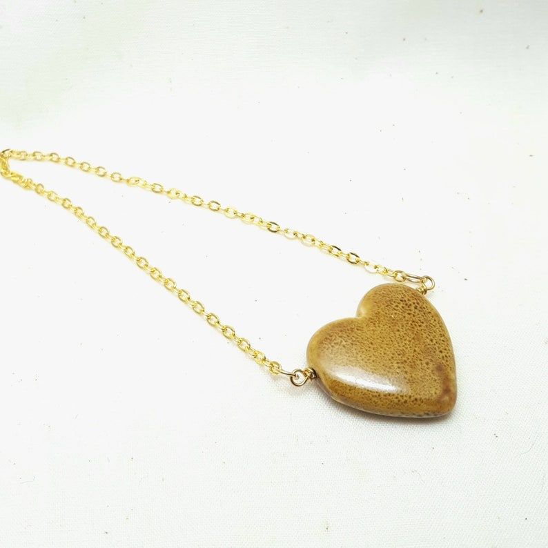Necklace Ceramic Heart Bead Goldtone Chain Topaz Stone image 0