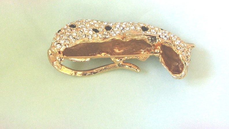 AVON Kenneth Lane Panther Brooch  Pin KJL AVON Book Piece Three dementional with green eyes black stones and lots of pave clear crystals