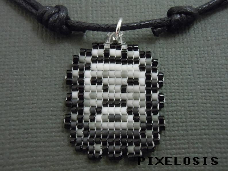 8c3d37a60b5 Collier de Twimp de perles de verre vidéo jeu de bijoux