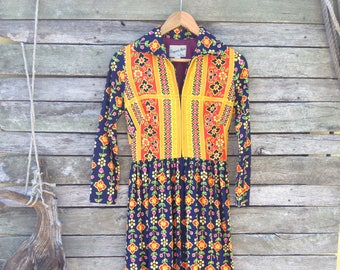 1960's 'Elegant Miss of California' multi colored mustard and blue, ethnic floral print long dress