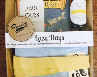 Unique vintage styled gift pack 'Lazy Days'. Handmade vintage cotton tote bag, vintage book and organic handmade sunscreen oil.