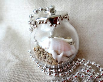 A Little  summer in a Glass ball pendant with silver plated chain Star sand from Okinawa Japan
