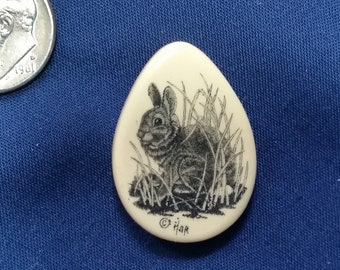 """Rabbit Scrimshaw by: Hop, Reproduction Polymer Scrimshaw. 1 1/16"""" tall by 3/4"""" wide."""