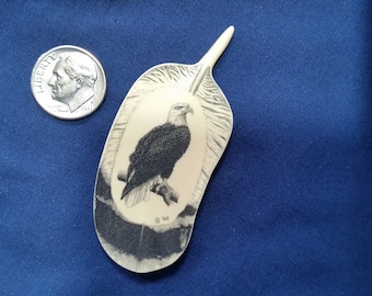 """Eagle Scrimshaw on Feather By: Hop, Reproduction Polymer Scrimshaw. 2 1/2"""" tall by 1 1/8"""" wide."""