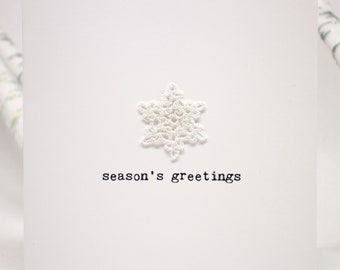 Season's greetings card with crochet snowflake