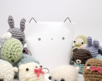 amigurumi mystery bag with surprise stuffed toy inside