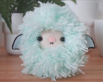 Mint green bat plush toy - fluffy pastel kawaii stuffed animal