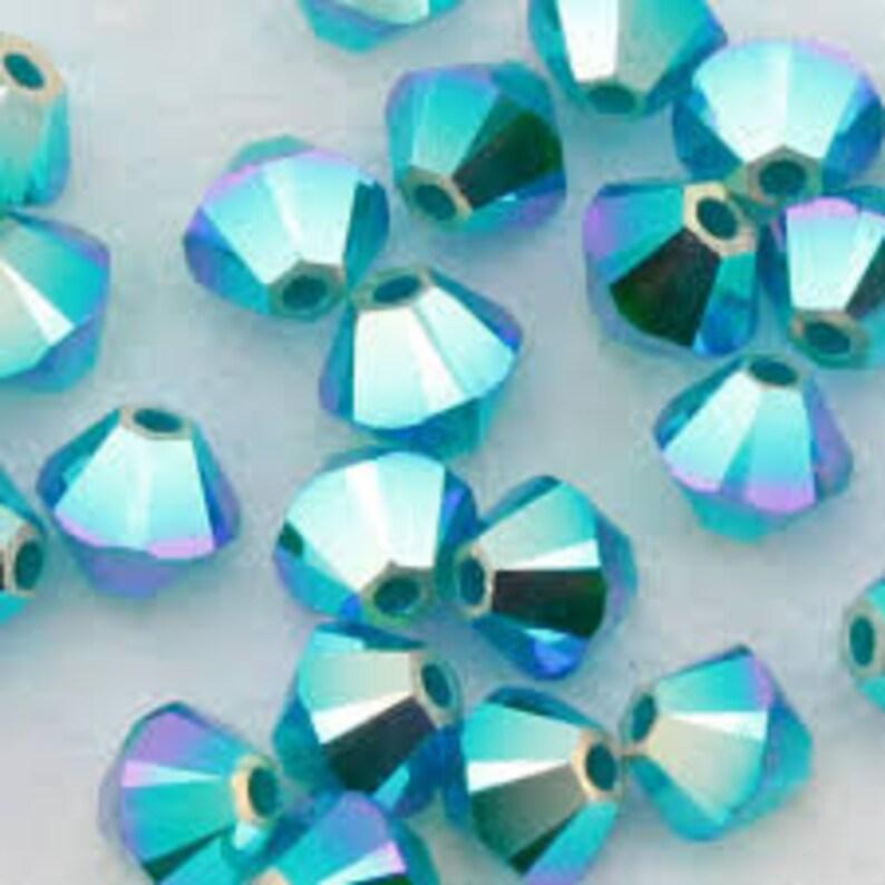 77a8011f0a542 Swarovski Caribbean Blue Opal AB2X 4mm Bicone Beads 144 Pieces #5328  Swarovski Crystal Bicone Beads